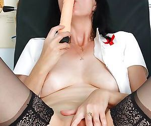 Lusty mature nurse in stockings masturbating her vag by..