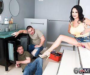 Dark haired cougar Rita Daniels seduces the male plumbers..