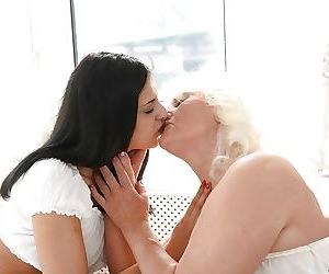 Mature lady Judi and barely legal cutie Coco de Mal have..