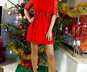 Mature woman in stockings presents her Christmas-themed show