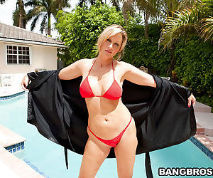 Outdoor pool posing of mature Jodi West with big tits will..