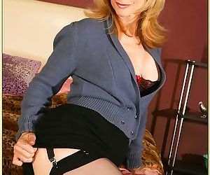 Busty mature Nina Hartley demonstrates her goodies in..