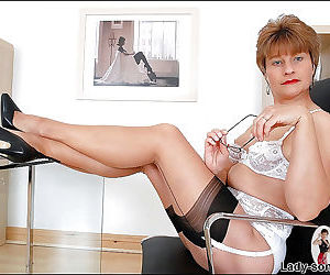 Mature fetish lady in glasses posing in lacy lingerie and..