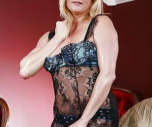 Curvy mature blonde Elexis Monroe taking off her lingerie
