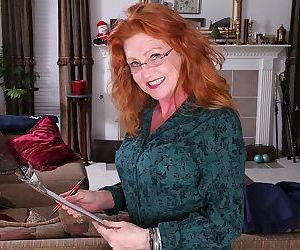 Redhead mature gal in glasses annd stockings undressing..