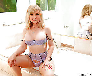 Mature Nina Hartley takes off lingerie and pays with her..