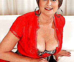 Chubby mature Victoria Peale posing upskirt and spreading..