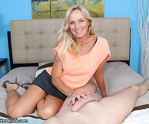 Mature MILF Dani Dare takes hold of a big dick and jerks..