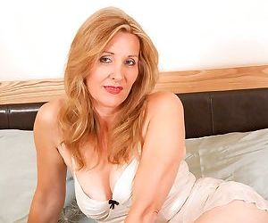 Mature lady Camilla plays with big enough dildo dreaming..