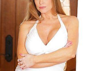 Mature solo model Darla Crane does a sexy striptease in..