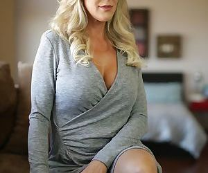 Julia Ann is a MILF stripping down naked on the couch and..