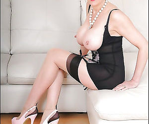 Mature fetish lady in girdle and stockings playing with..