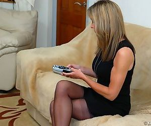 Naughty older housewife Satin Jayde pulls down sheer..