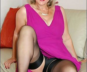 Voluptuous mature lady strips to her sleek lingerie and..