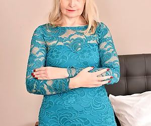 Older British housewife Emma Turner plays with herself..