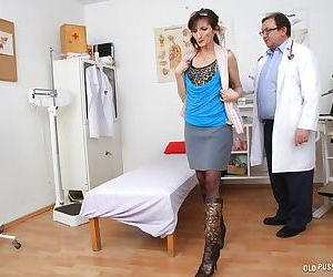 Mature lady Andula undergoes pussy examination at..