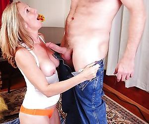 Blonde mature mom gives a nasty titjob with her big tits..