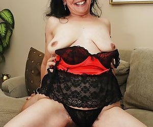 Slender mature Miss Nina Swiss is riding on this hard big..