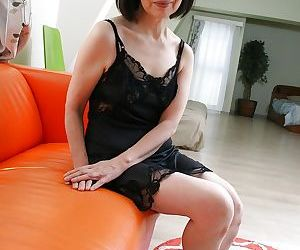 Mature Asian Mitsuyo Morito reveals her hairy pussy and..