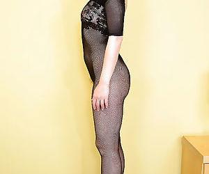 Older solo model Mischelle posing revealingly in..