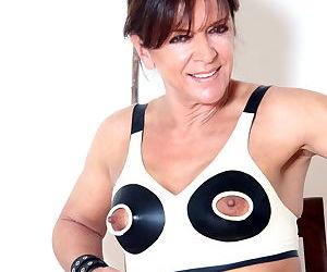 Kinky European woman Lady Sarah posing in nippleless bra..
