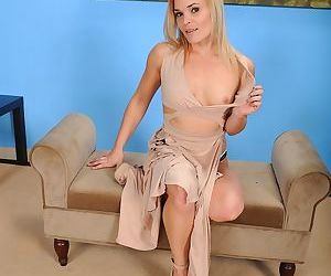 Sharp featured mature Blaten Lee lifts her legs to display..