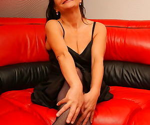Naughty mature slut dripping on a leather couch - part 2971