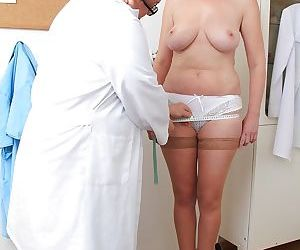 Mature babe gets her hairy pussy checked with a gyno tool..