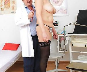 Mature woman in stockings has her hairy vagina checked out..