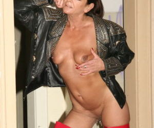 Sexy mature woman Lady Sarah flashing her pierced vagina..