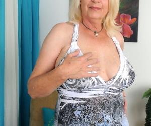 Hot mature Angelique tweaks her pierced big boobs &..