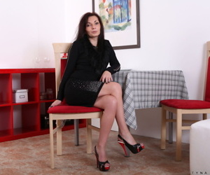 Mature lady Tyna Black shows her great legs before..