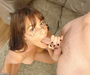 Kinky mom in glasses offers her stepdaughter a big cock to..