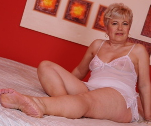 Short haired blonde granny Ursula Grande receives pussy..
