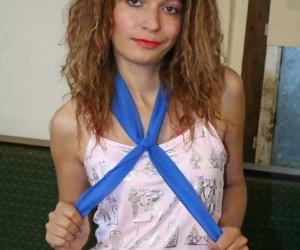 Slutty Russian woman with petite body Gina X strips down..