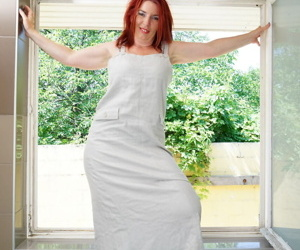 Older redhead takes a break from housework to masturbate..