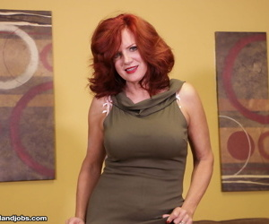 Horny mature woman with red hair and big tits jerks off..
