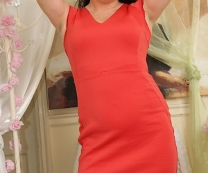 Stunning woman Sarah Kelly takes off red dress and gently..