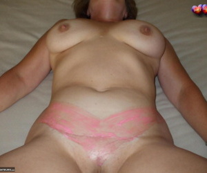 Mature amateur Busty Bliss catches jizz on her tan lined..