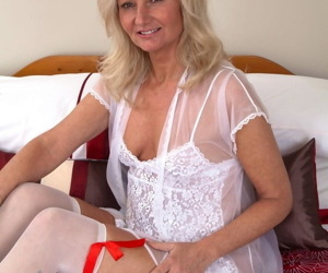 Nasty blonde granny Ellen posing in white lingerie and..