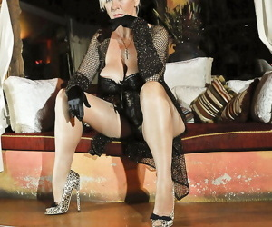 Ravishing mature vixen in lingerie and stockings flashing..