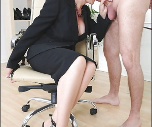 Mature fetish lady in formal suit gives a sloppy blowjob