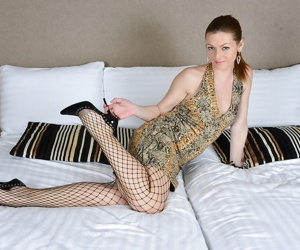 Mature woman Mischelle removing fishnet pantyhose from..