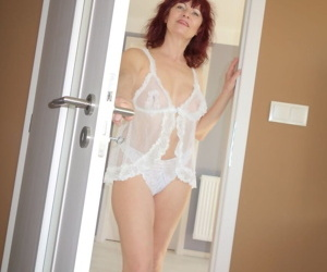 Older redhead Wanda slides white lace panties aside before..