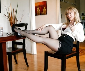 Busty mature mom Nina Hartley in in high heels on knees..