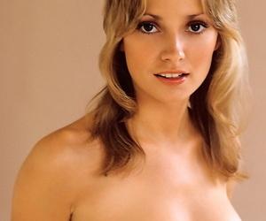 Big-eyed busty centerfold Cyndi Wood poses naked to show..