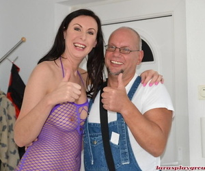 Busty hot mature in fishnet lingerie enjoys DP with a..