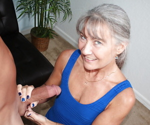 Aged grey haired woman jerks fat cock POV style for..