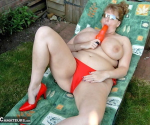 Mature BBW CurvyClaire toys her pussy on lounge chair in..