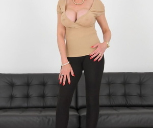 Mature MILF Lady Sonia slides black leggings over thong..